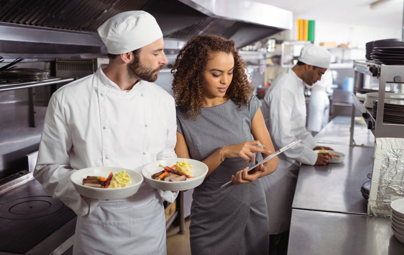 Canada-Ontario Job Grant - a chef receiving training from a woman with a clipboard